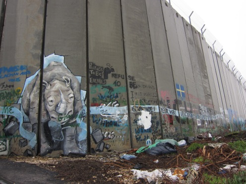 Graffiti artists brighten up the wall