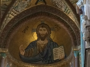 The mosaic covers the dome of the apse