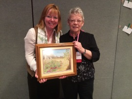 Mary Lou presents the painting to Janet at the 'Women on Fire' Retreat - Chicago April 2014