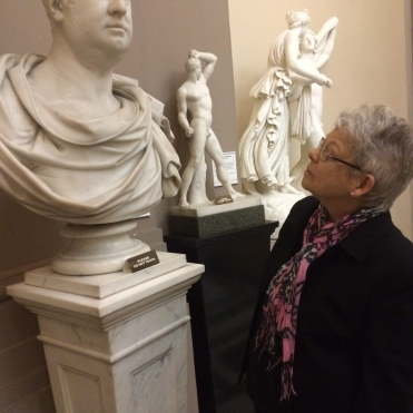 Mary Lou inspecting a Roman portrait bust