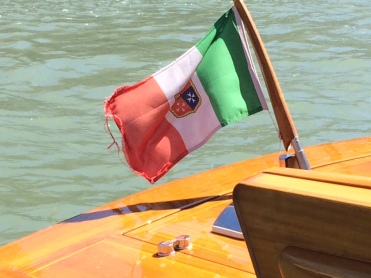 The Italian flag on the Grand Canal, flying proudly at the stern of a private water taxi. Venice, Italy. www.educated-traveller.com