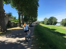 Lucy on her bicycle by the Loire