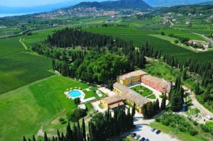Villa Cordevigo - fabulous country house hotel, the bijou San Martino Chapel is on the right of the courtyard, adjacent to the cypress trees.