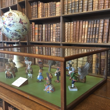 A Globe decorated with Carroll's fantastical characters