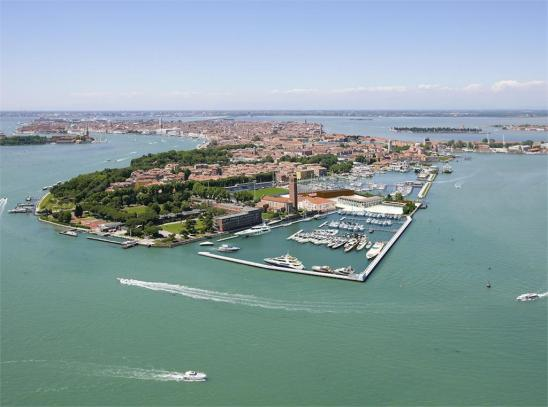 Venice - aerial view looking west. Public gardens in the foreground. Giudecca Island to the left. San Marco and Bell Tower in the distance, slightly to the left of centre.
