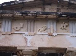 Delphi temple pedinent detail