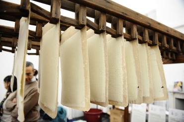 Sheets of cotton fibres hang to dry in 'Museo della Carta' Fabriano