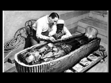 Howard Carter examines the sarcophagus of Tutankhamun