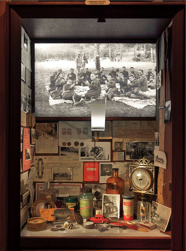 This display case shows the elements of life that invoke memories, photos, medicines, toys...