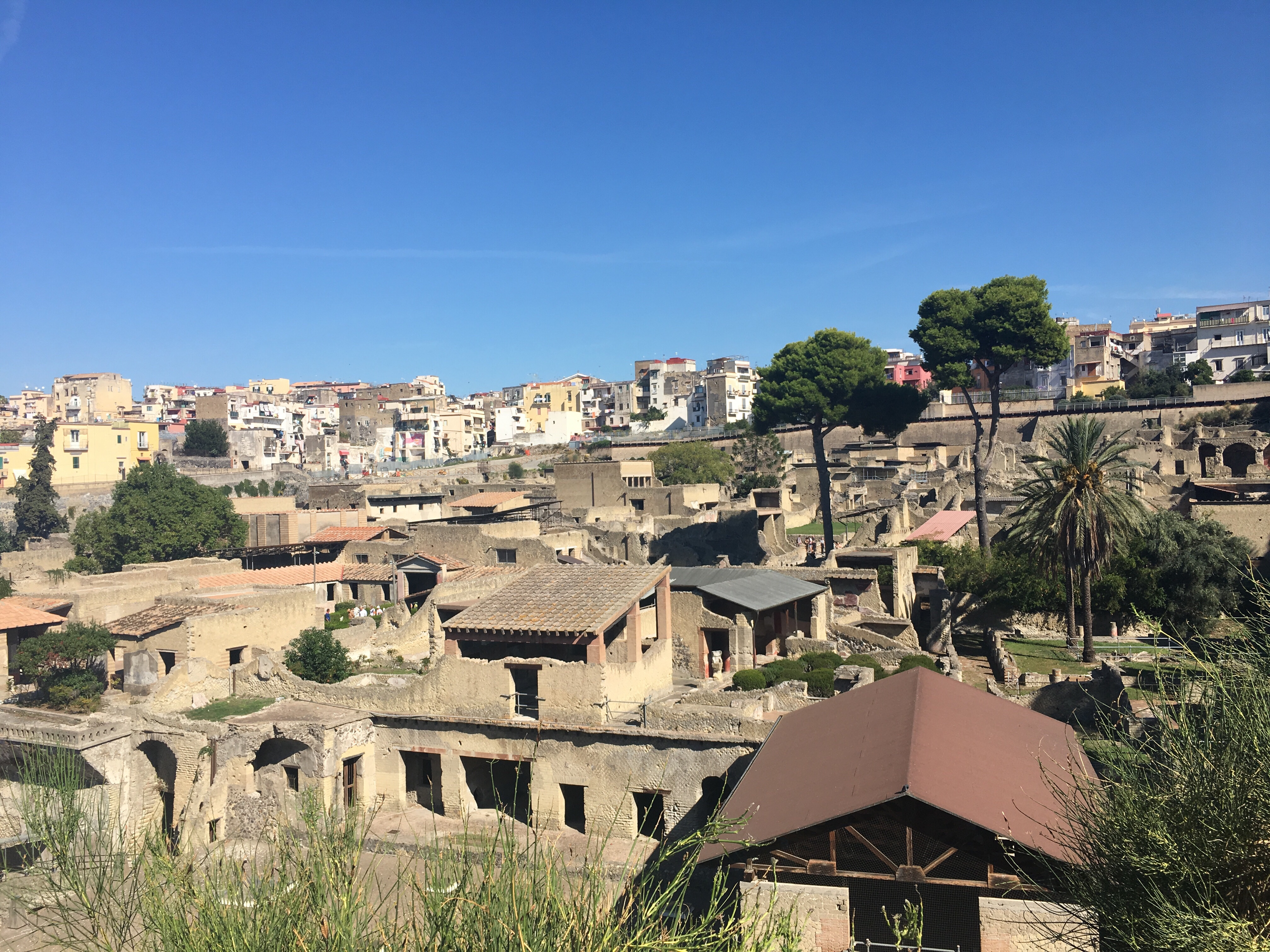 Herculaneum - perfect example of the old buildings (Roman) at the bottom of the photo with the modern town of Ercolano above.