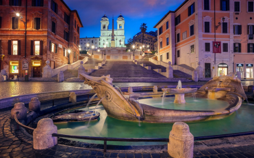 Spanish Steps leading up to Trinita dei Monti. Bernini's La Barcaccia Fountain in the foreground