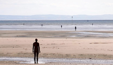 Liverpool - on the beach, the Antony Gormley statues sum up Liverpool and it's relationship with the sea