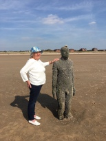 Mary makes it across the beach to one of the statues - July 2016