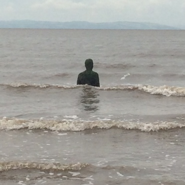 As the tide comes in many of of the Antony Gormley statues are submerged.