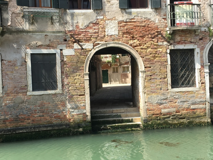 Venice - water gate: www.educated-traveller.com