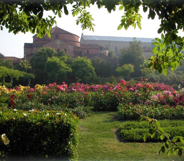 Locanda Cipriani - the verdant, green gardens with the Church of Santa Fosca in the background