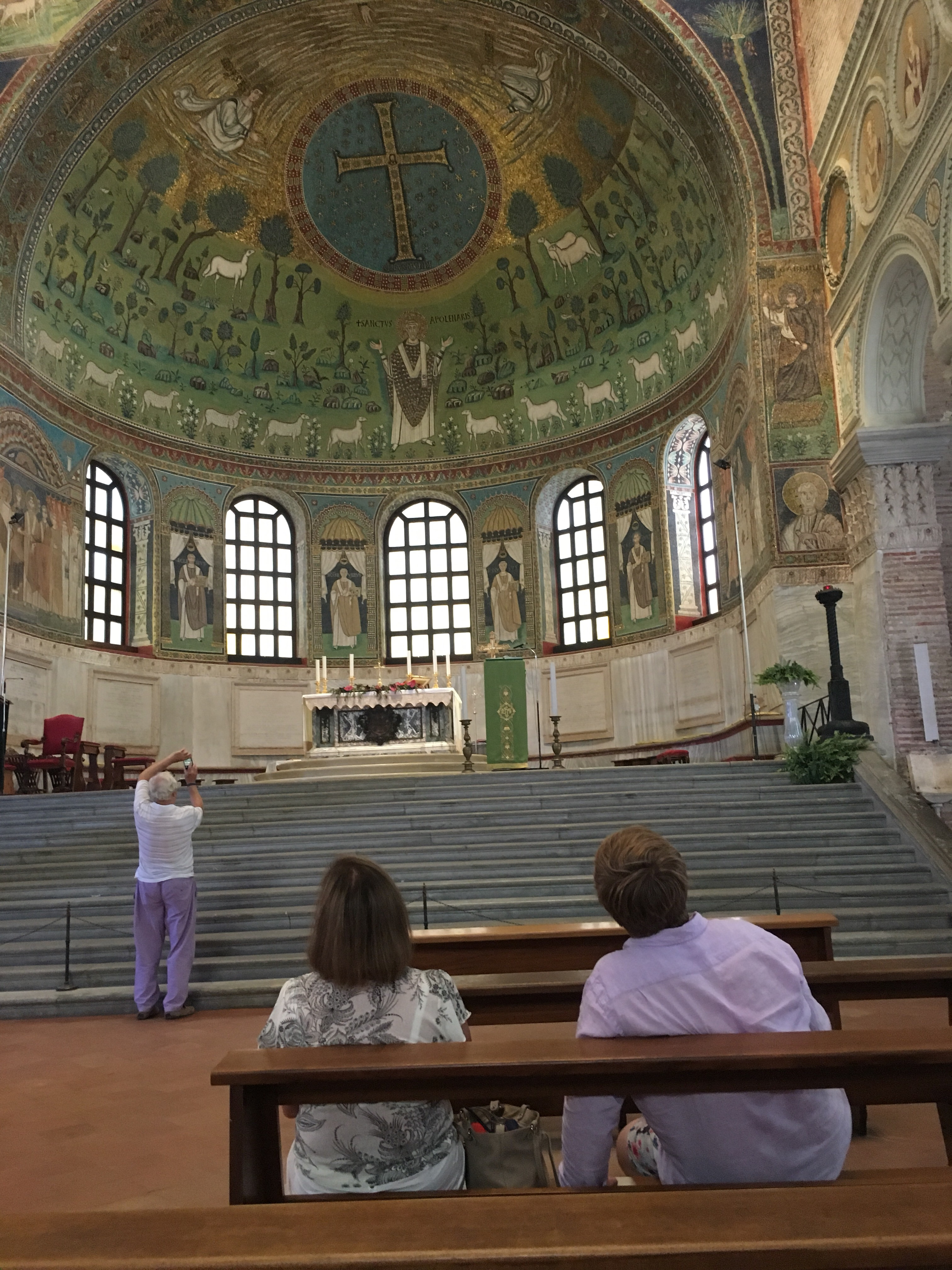 Visitors gaze in awe at the mosaics that decorate the apse, Sant' Apollinare in Classe