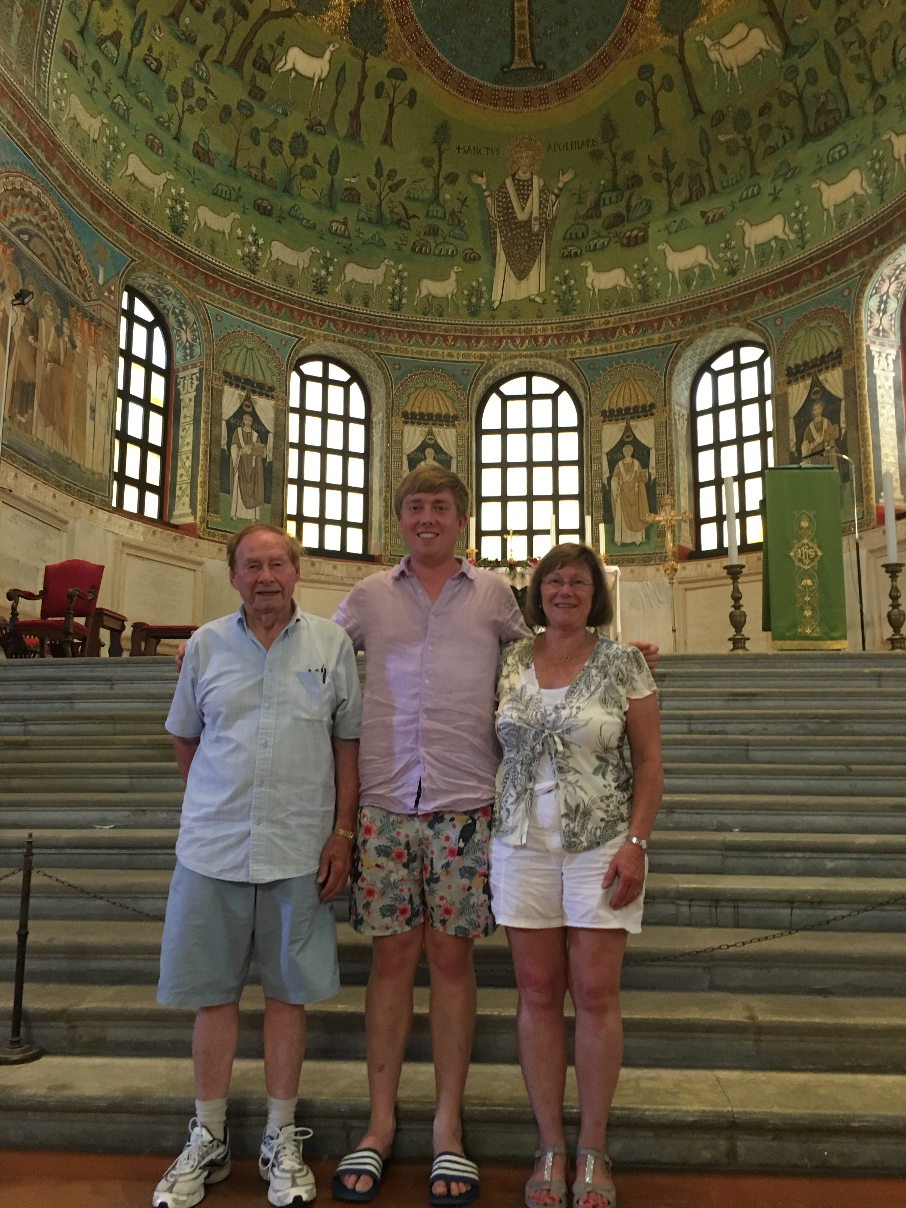 Visitors gaze in awe at the mosaics that decorate the apse, Sant' Apollinare in Classe - www.educated-traveller.com