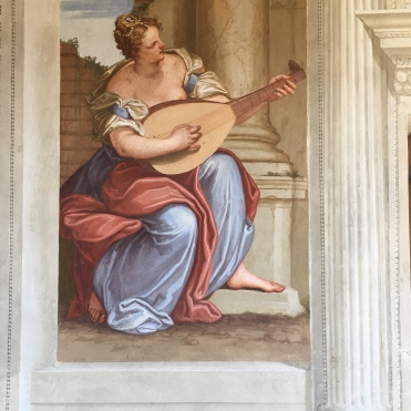 The art of music is depicted in this scene.
