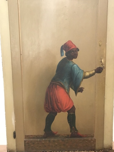 This young servant boy is painted exiting the public gallery