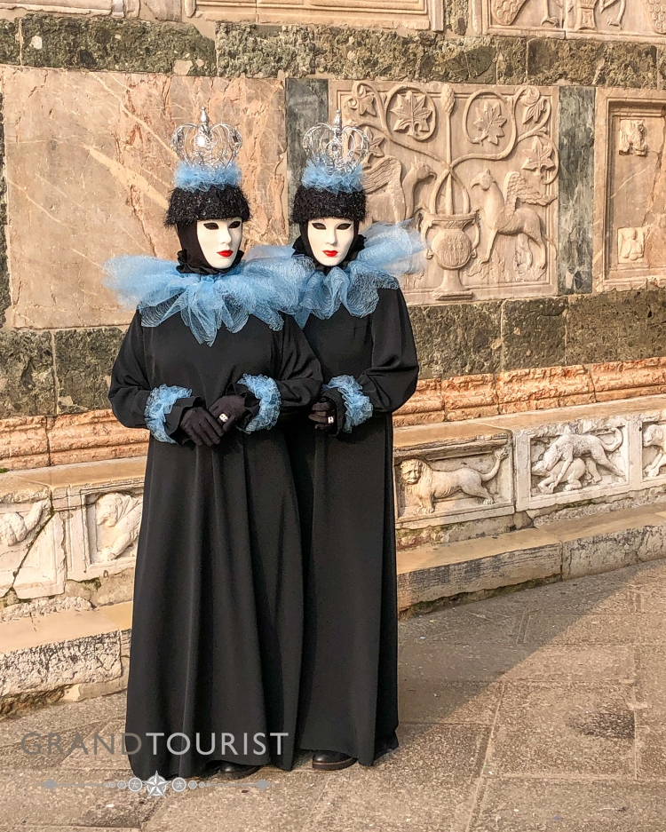 Venice - Carnevale - Grand Tourist - The twins pose and reveal the extraordinary detail of carving on the facade of St Mark's.