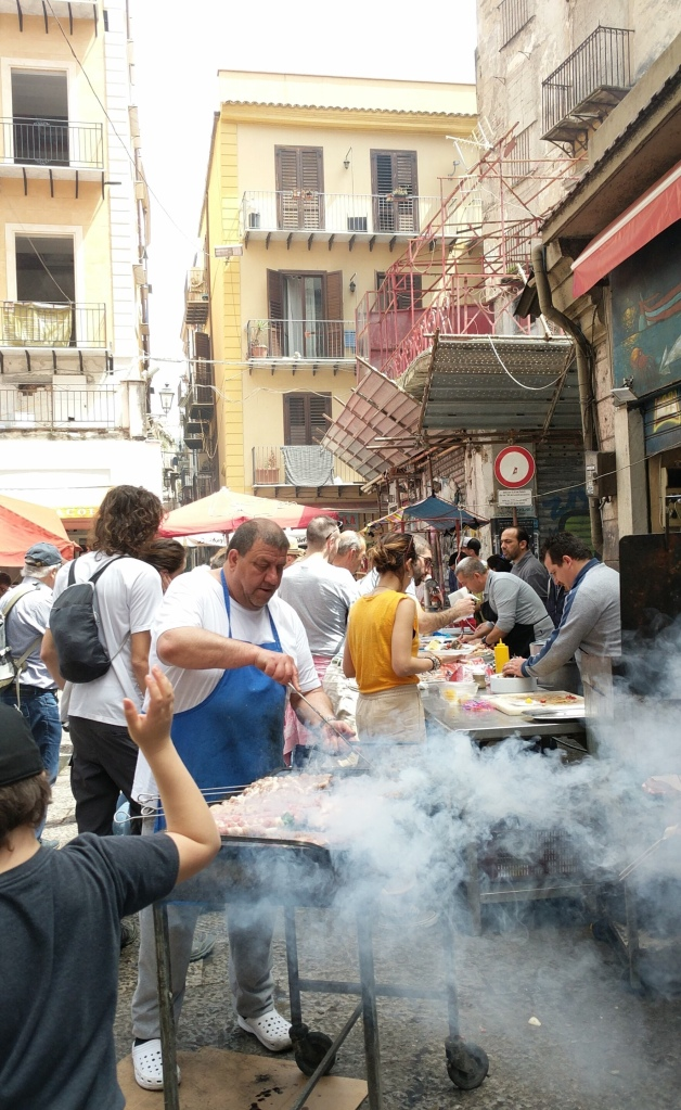 It's hard work running a barbecue, Palermo, Sicily