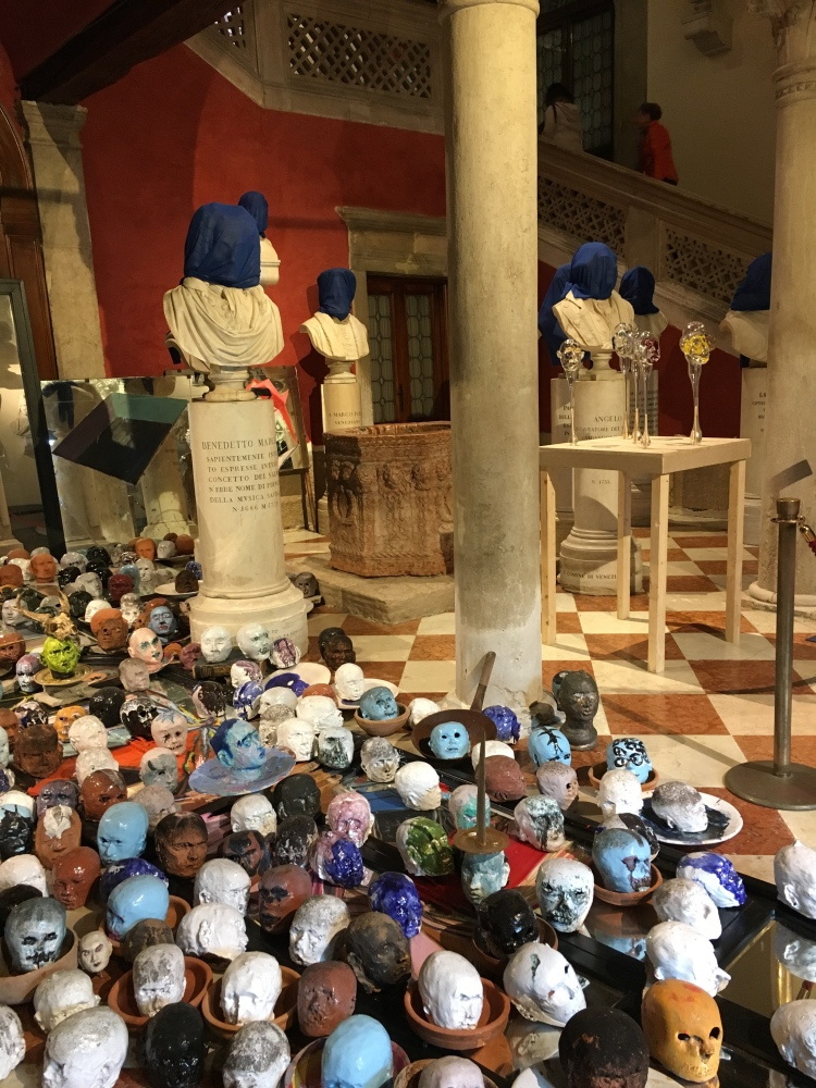 Palazzo Loredan - portrait busts covered by Cuban artist Carlos Quintana - with numerous glass and plaster skulls at their feet - Biennale, 2019