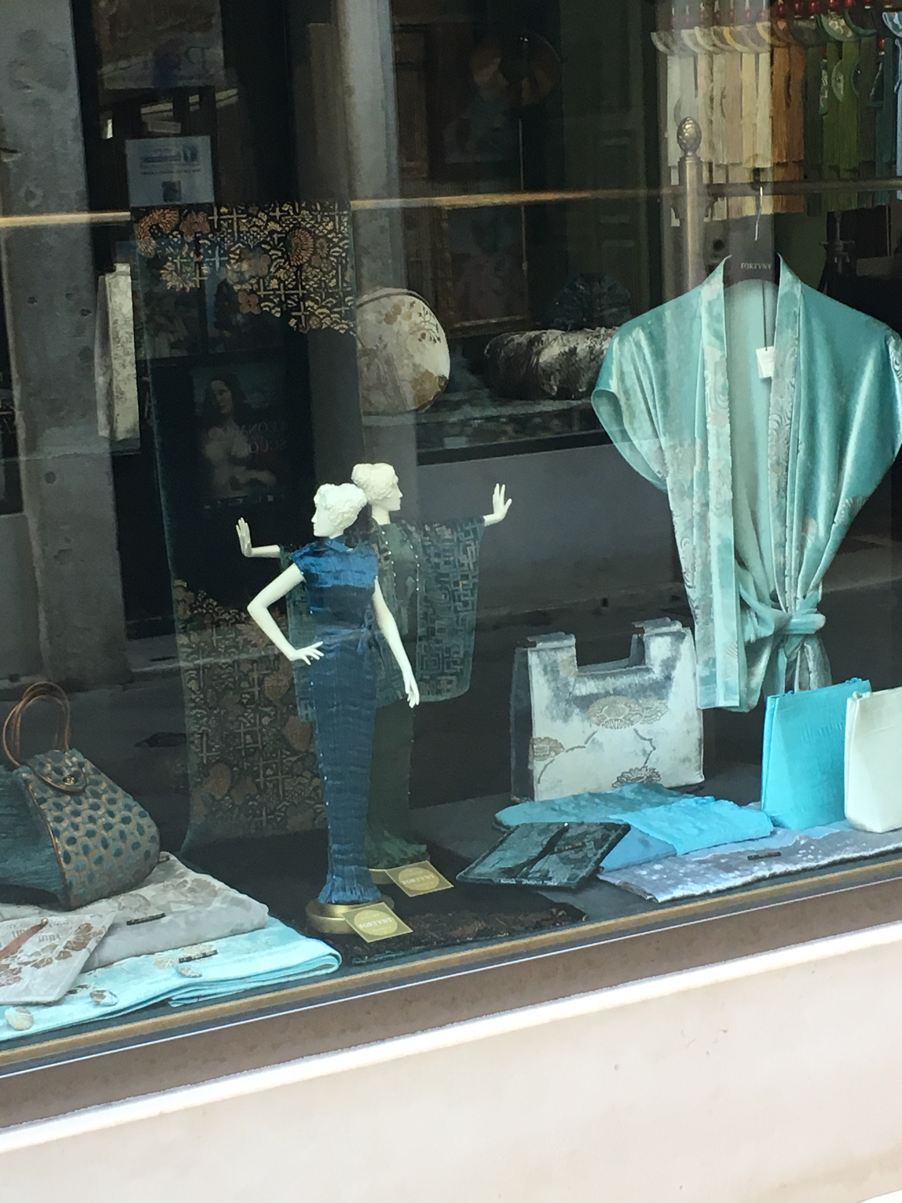 Fortuny is still going strong in Venice today - their shop window, Venice - June 2019