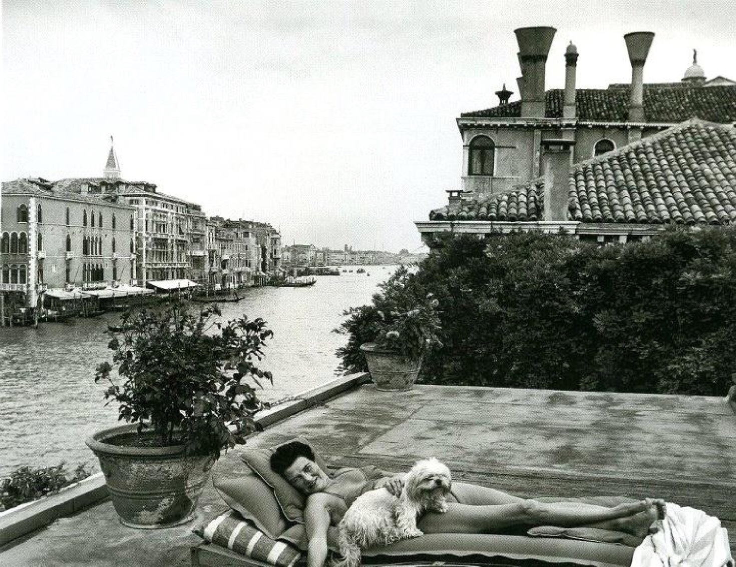 Peggy Guggenheim - relaxing on the roof of her palazzo, Venice