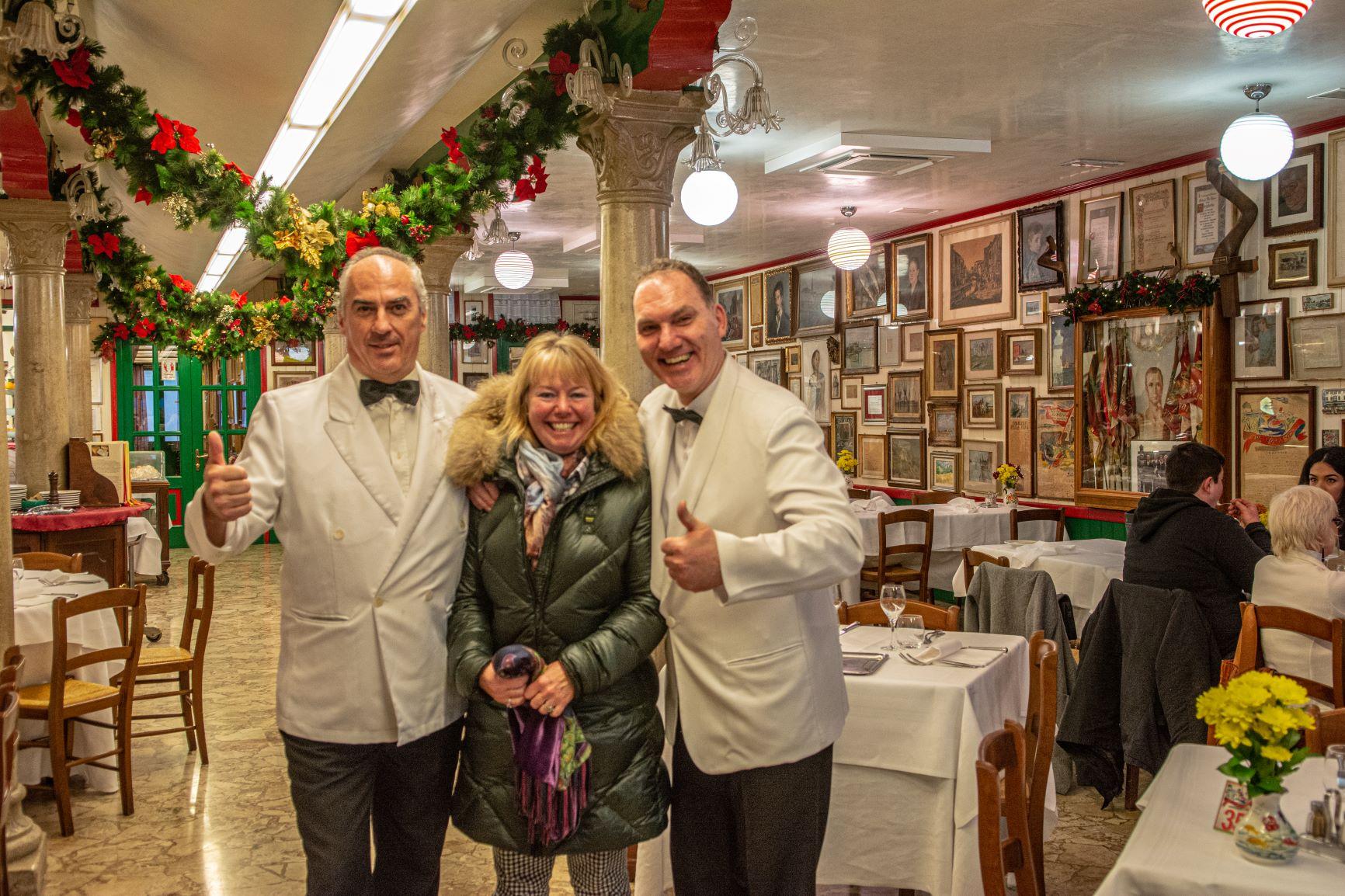 Dec 2019 - Da Romano Burano - Janet with waiters in my favourite restaurant in the lagoon, Da Romano - photo by Mark Caplan.