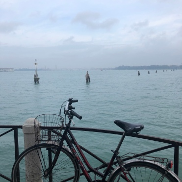 Venice - a bicycle gazes whimsically across the lagoon.