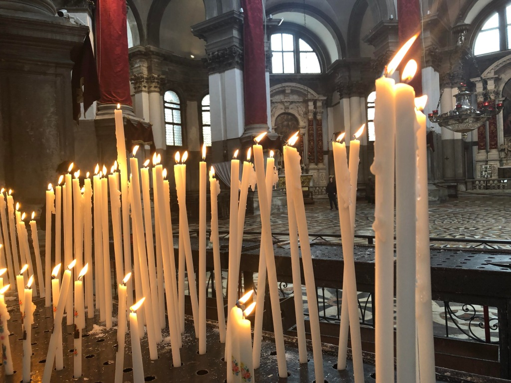 A forest of candles in the church