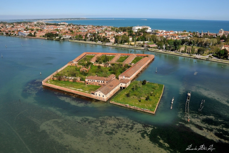 Venice - Quarantine Island of Lazzaretto Vecchio with Lido di Venezia in background. Beyond that is the Adriatic Sea