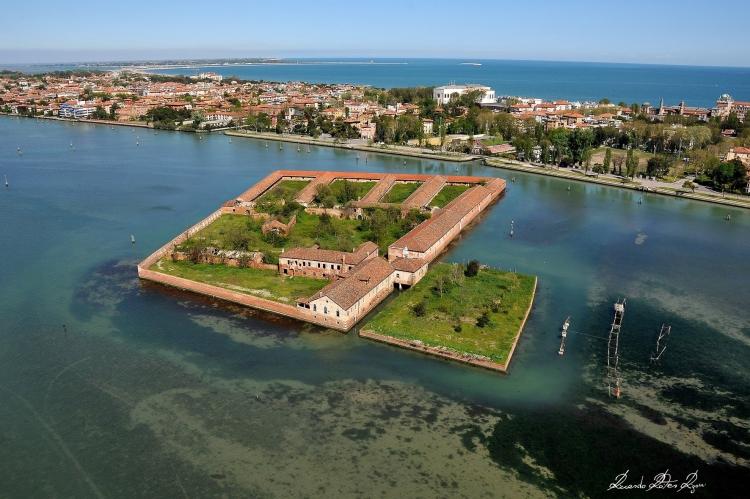 Venice - Quarantine Island of Lazzaretto Vecchio with Lido di Venezia in background. Beyond that is the Adriatic Sea