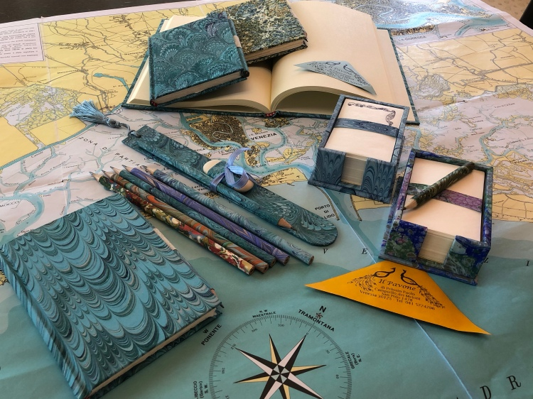 Il Pavone - Venezia sells a superb range of handmade note books, hand coloured papers, pencils and wonderful waste-paper baskets for the office.