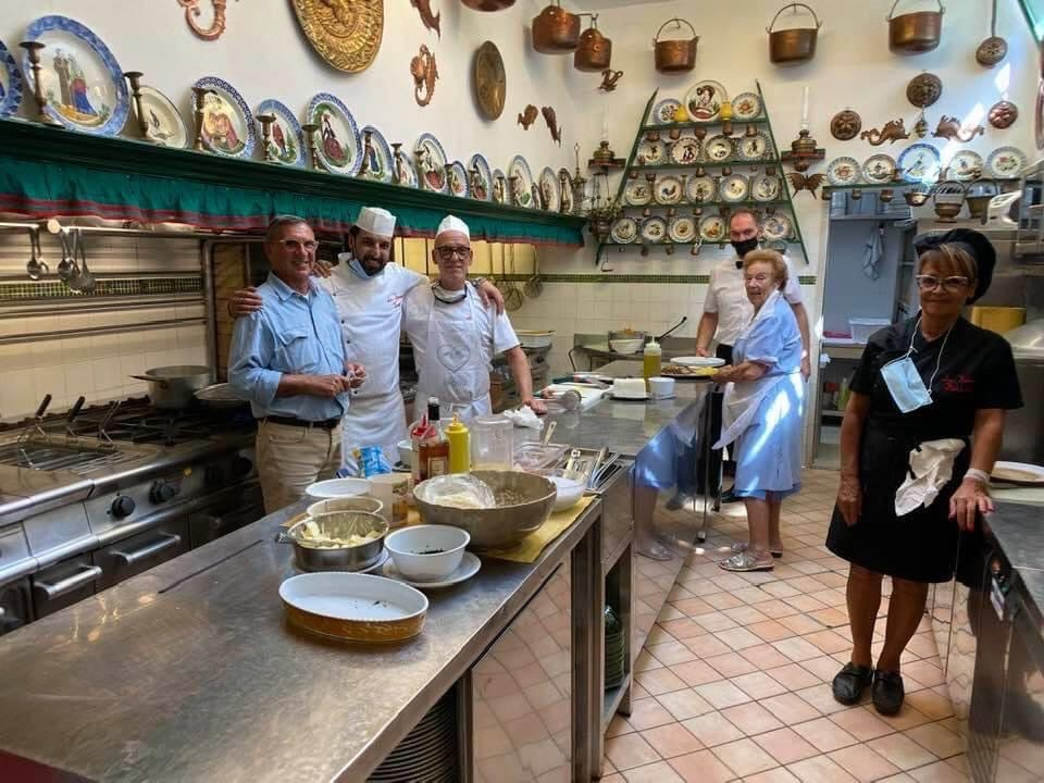 Here's Linda in the kitchen, second from right. The kitchen is just like home. Signora Linda steers the ship