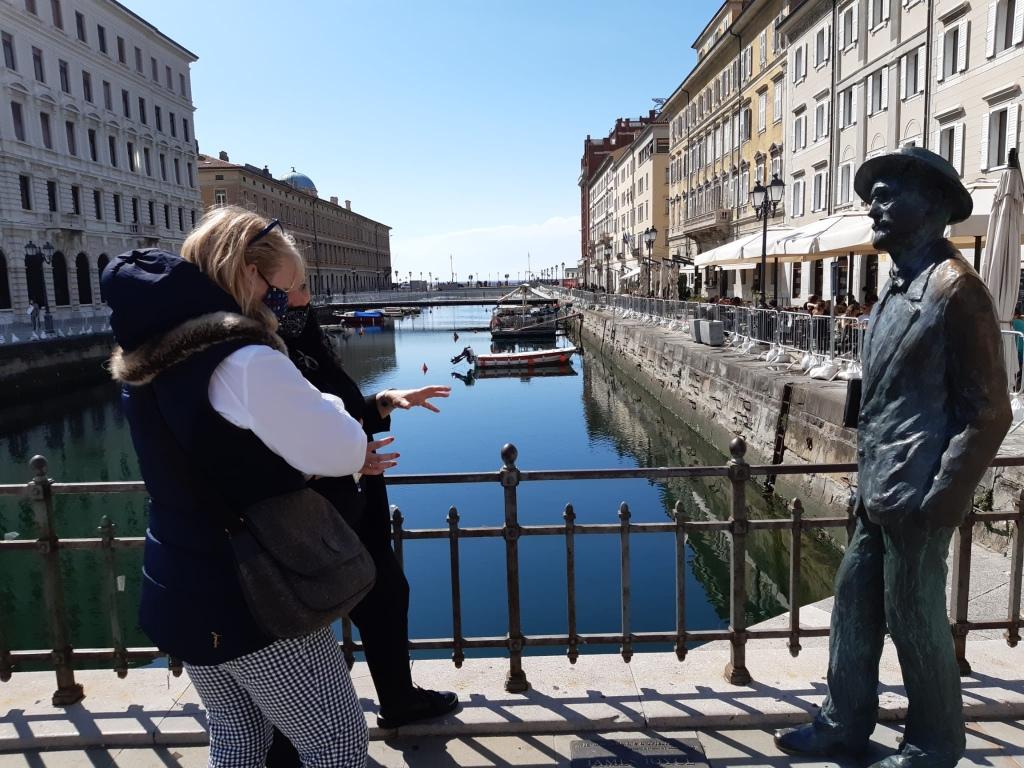 A statue of James Joyce strolling by Trieste's Canale Grande